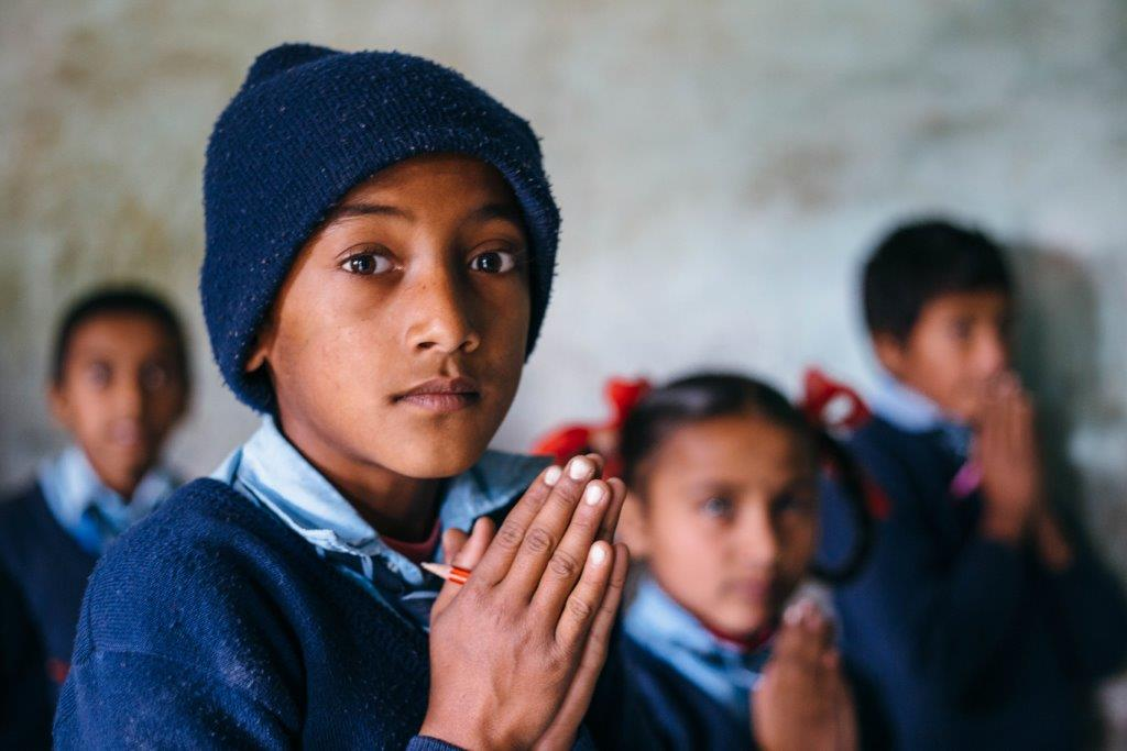 nepal school boy prayer hands
